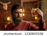 barman with whisky or brandy.... | Shutterstock . vector #1230833338