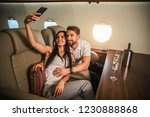 happy couple travelling on a... | Shutterstock . vector #1230888868