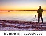 silhouette of man photographer... | Shutterstock . vector #1230897898