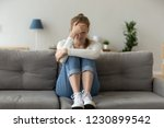 unhappy female sit on sofa...   Shutterstock . vector #1230899542