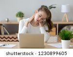 exhausted young female sit at... | Shutterstock . vector #1230899605