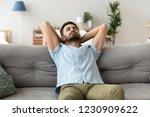 calm millennial man relax on... | Shutterstock . vector #1230909622