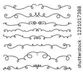 collection of handdrawn swirls... | Shutterstock .eps vector #1231017388