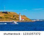 A Fishing Boat Past A Small...