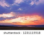 dramatic colorful sunset sky... | Shutterstock . vector #1231115518