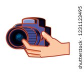 hand with photographic camera... | Shutterstock .eps vector #1231123495
