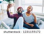 happy dark skinned male and... | Shutterstock . vector #1231155172
