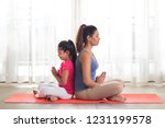 mother and daughter doing yoga...   Shutterstock . vector #1231199578