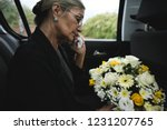 sad widow on the way to the... | Shutterstock . vector #1231207765