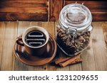 cup of hot coffee and coffee... | Shutterstock . vector #1231209655