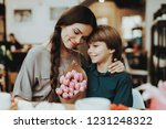 little and mother happy... | Shutterstock . vector #1231248322