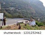 hairpin bend watchers | Shutterstock . vector #1231252462
