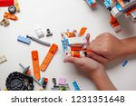 child collects robot from the... | Shutterstock . vector #1231351648
