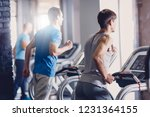 a group of young men doing... | Shutterstock . vector #1231364155