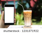 young hipster using smart phone ... | Shutterstock . vector #1231371922