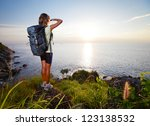 hiker with backpack standing on ... | Shutterstock . vector #123138532