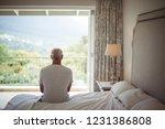 senior man in bedroom looking... | Shutterstock . vector #1231386808