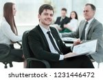 business man at office with his ... | Shutterstock . vector #1231446472