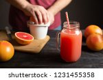 freshly squeezed grapefruit... | Shutterstock . vector #1231455358