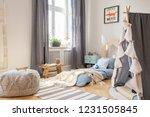 pouf and tent in scandinavian... | Shutterstock . vector #1231505845