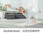 man standing in balancing the... | Shutterstock . vector #1231528495