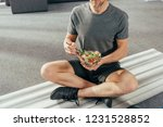 cropped shot of athletic man in ... | Shutterstock . vector #1231528852