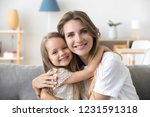 happy loving young mother... | Shutterstock . vector #1231591318