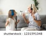 happy senior grandmother and... | Shutterstock . vector #1231591348