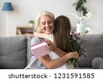 happy senior grandma hugging... | Shutterstock . vector #1231591585