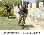 woman paintball player in full... | Shutterstock . vector #1231601245