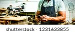 carpenter using phone while... | Shutterstock . vector #1231633855