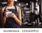 mid section of waitress taking... | Shutterstock . vector #1231633912