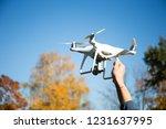 man cattching landing drone | Shutterstock . vector #1231637995