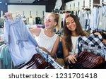 two happy girls shopping top... | Shutterstock . vector #1231701418