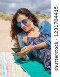 brunette woman with sunglasses...   Shutterstock . vector #1231704415