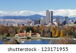 Scenic of Denver Colorado skyline, with Rocky Mountains in the background and City Park Lake in the foreground. - stock photo