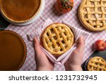 hands holding a tray with an... | Shutterstock . vector #1231732945