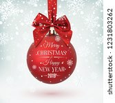 red christmas ball with ribbon... | Shutterstock . vector #1231803262