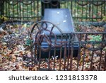 the plot of a grave with a dark ... | Shutterstock . vector #1231813378