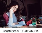 cute girl sitting at a desk in... | Shutterstock . vector #1231932745
