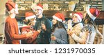 friends group with santa hats... | Shutterstock . vector #1231970035