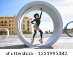 young fit black woman on roller ... | Shutterstock . vector #1231995382