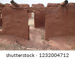 very old adobe walls to a house ... | Shutterstock . vector #1232004712