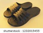 black plastic sneakers on a... | Shutterstock . vector #1232015455