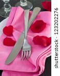 fork and knife on pink napkin | Shutterstock . vector #123202276