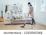 asian lady doing house chores... | Shutterstock . vector #1232042368