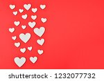 red and white hearts on a red... | Shutterstock . vector #1232077732