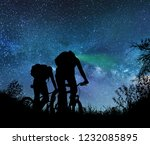 couple ride bicycles at night... | Shutterstock . vector #1232085895
