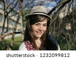 portrait of a woman with hat. | Shutterstock . vector #1232099812