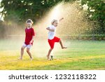 kids play with water on hot... | Shutterstock . vector #1232118322